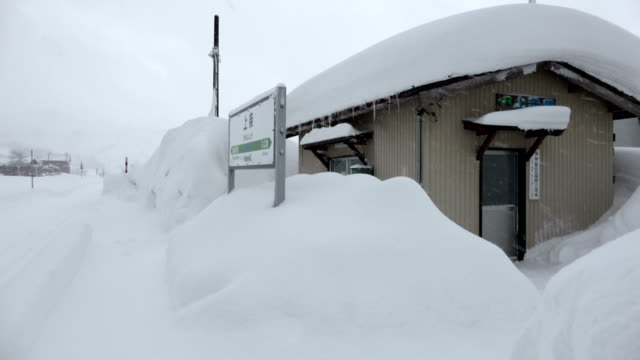 Rural railway station in Japan buried in snow after major winter storm