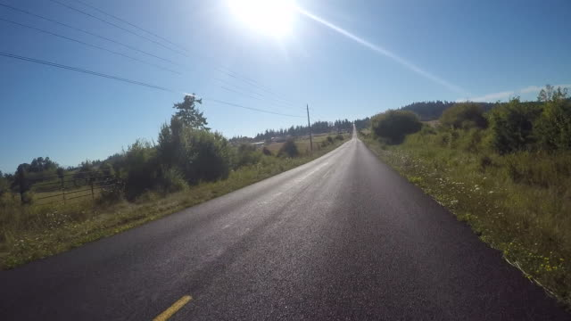 A rural road on San Juan Island near Lime Kiln State Park on a warm sunny day.