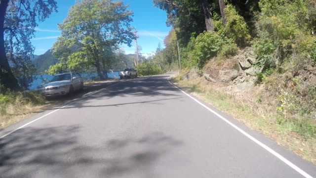 a rural road on san juan island near lime kiln state park on a warm sunny day. - pacific northwest usa stock videos & royalty-free footage