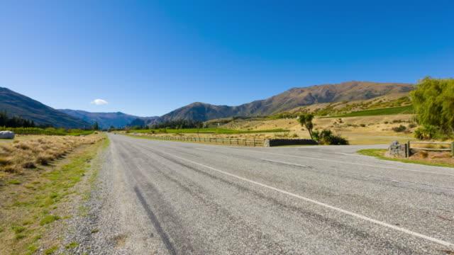 Rural Scene of Asphalt Road with Meadow ,New Zealand