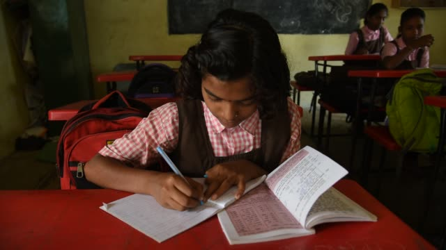 rural school student learning in the classroom, maharashtra, india. - schoolgirl stock videos & royalty-free footage