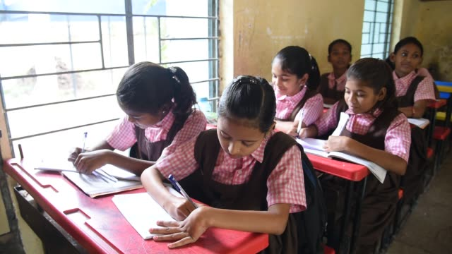 rural school student learning in the classroom, maharashtra, india. - girls stock videos & royalty-free footage