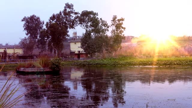 農村の日没の風景 - 村点の映像素材/bロール