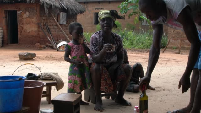 rural togo; november 8, 2019; three women are performing a voodoo ritual with three dolls. during ceremonies and observances, followers of voodoo ask... - traditional ceremony stock videos & royalty-free footage