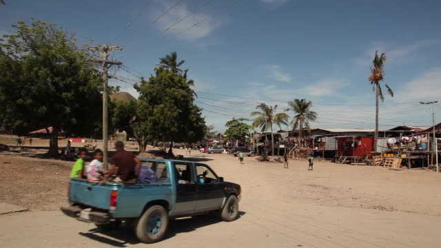 rural village along the main street papua new guinea is an island located in oceania there are around 850 languages spoken on the island and there is... - oceania stock videos and b-roll footage