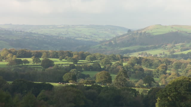 rural welsh valley in llandysul with passing clouds causing shadows - valley stock videos & royalty-free footage
