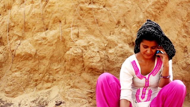 Rural women talking on mobile phone