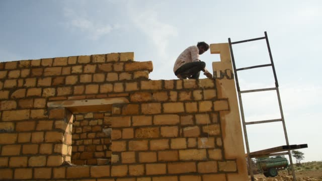 rural workers build home, rajasthan, india. - wall building feature stock videos & royalty-free footage