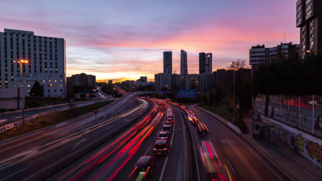 Rush hour and Four Tower Sunrise Time lapse in Madrid