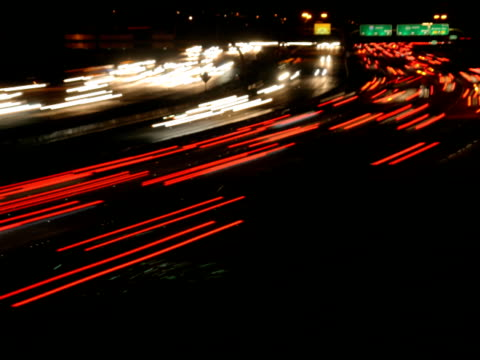 ntsc rush hour freeway traffic time lapse video - tail light stock videos & royalty-free footage