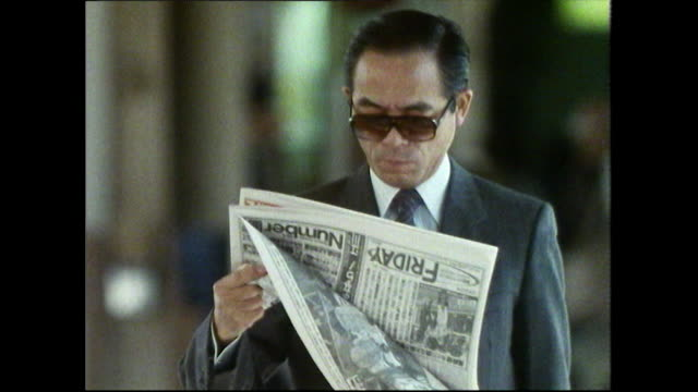 rush hour in a kyoto train station; 1989 - bbc archive stock-videos und b-roll-filmmaterial