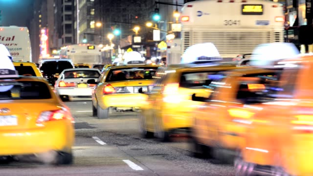 vídeos de stock e filmes b-roll de lapse rush hour mass transit traffic public transportation yellow taxis herald square 34th street midtown manhattan broadway fashion district new... - 2013
