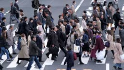 Rush hour on Crosswalk street at Shinjuku Tokyo japan , SLOW MOTION