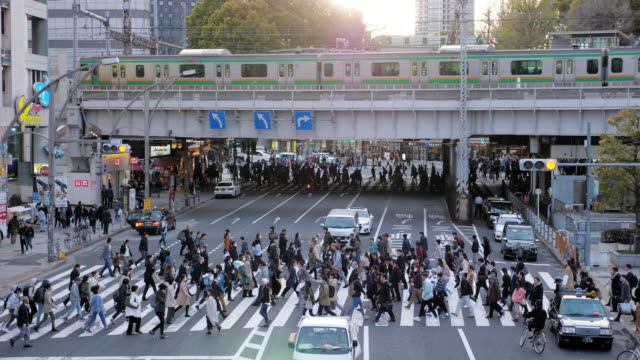 rush hour on the road in ueno station tokyo japan - overworked stock videos & royalty-free footage