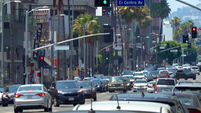 rush hour traffic and cnn communication broadcast tower and satellite antennas broadcasting breaking news on sunset boulevard in los angeles, california, 4k - channel 4 news stock videos & royalty-free footage