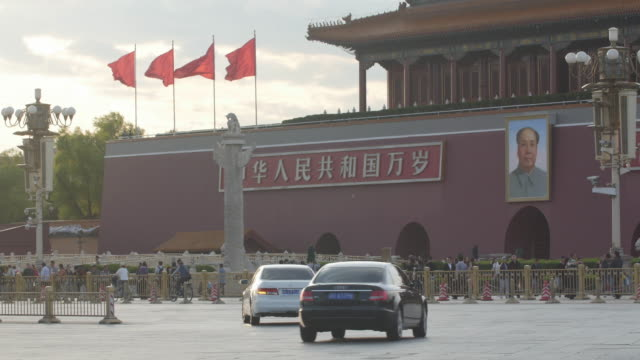 Rush hour traffic and police car at the Tiananmen Square in Beijing, China