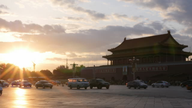 Rush hour traffic and Sunset at the Tiananmen Square in Beijing, China