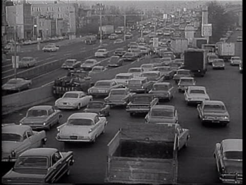 Rush hour traffic during NYC transit strike / cars entering heavy traffic on highway / traffic jam NYC Transit Strike on January 06 1966 in New York...