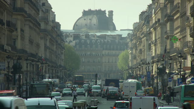ws rush hour traffic on city street, paris, france - avenue de l'opera stock videos & royalty-free footage