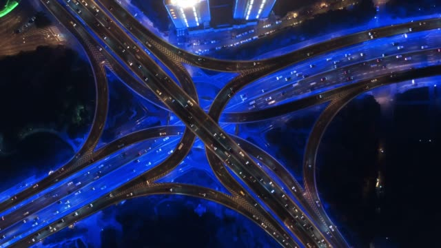 ws rush hour traffic on multiple highways and flyovers at night / shanghai, china - elevated road stock videos & royalty-free footage