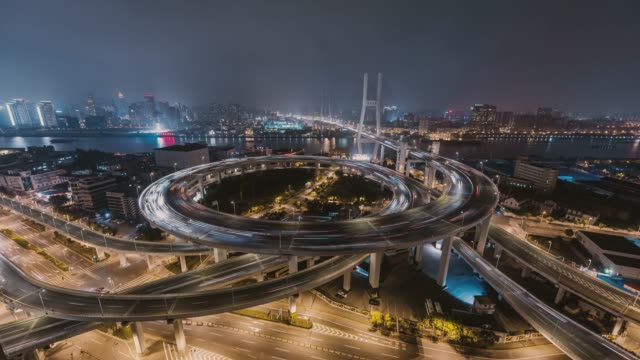 t/l rush hour traffic on multiple highways and flyovers at night / shanghai, china - blockchain stock videos & royalty-free footage