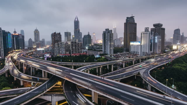 T/L WS HA PAN Rush Hour Traffic on Multiple Highways and Flyovers, Day to Night Transition / Shanghai, China