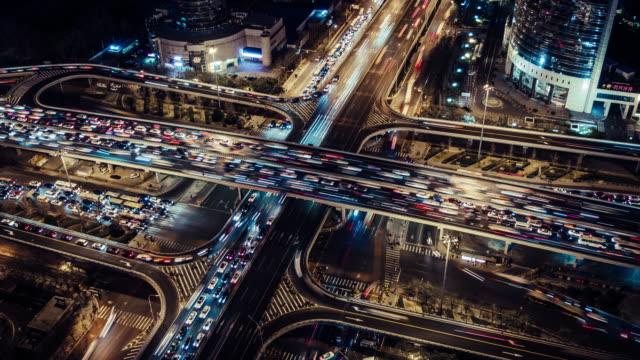 vídeos de stock, filmes e b-roll de t/l ha hora do rush do tráfego em várias estradas à noite / beijing, china - pequim