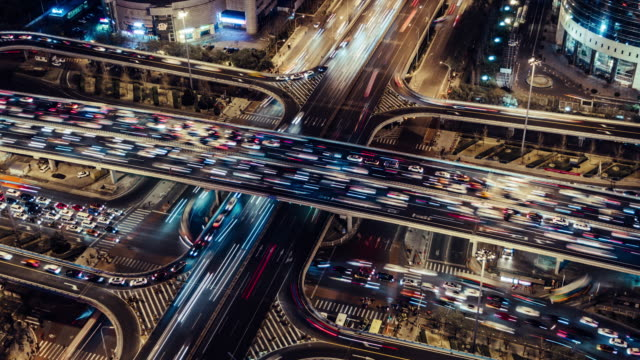 t/l ha zo rush hour traffic on multiple highways at night / beijing, china - road junction stock videos & royalty-free footage