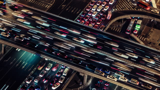 t/l ha pan rush hour traffic on multiple highways at night / beijing, china - development stock videos & royalty-free footage