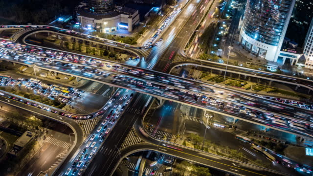 t/l ws ha rush hour traffic on multiple highways at night / beijing, china - traffic time lapse stock videos & royalty-free footage
