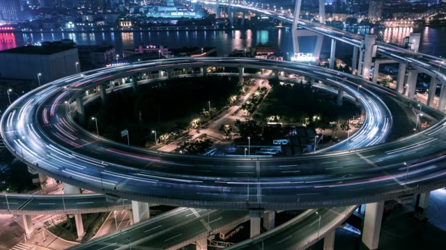 t/l pan rush hour traffic on multiple highways / shanghai, china - traffic time lapse stock videos & royalty-free footage
