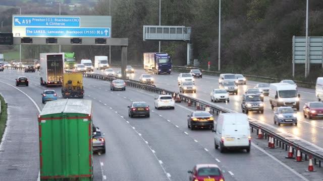 Rush hour traffic on the M6 Motorway near Preston, Lancashire, UK at dusk
