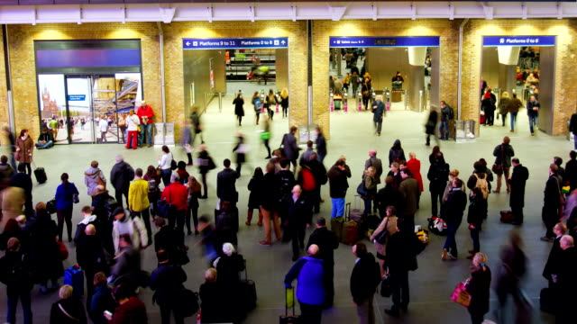 Rush hour train station people movement, London, time lapse