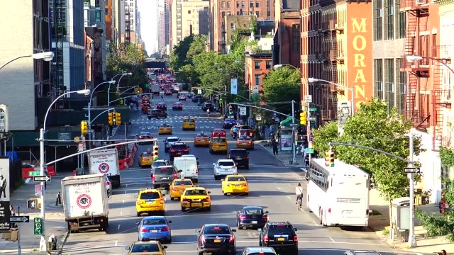 Rush Hour vehicular traffic on 10th Avenue between West 17th and 18th Streets in lower Manhattan New York City USA