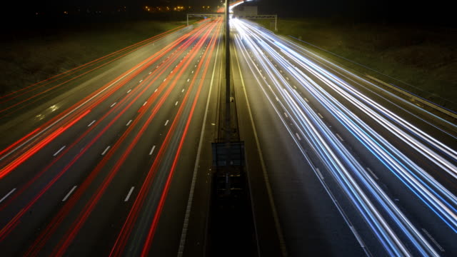 rush-hour traffic rapidly flows along m1 motorway - headlight stock videos & royalty-free footage