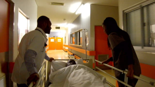 rushing a patient to the emergency room - stretcher stock videos and b-roll footage