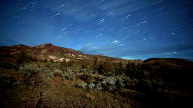 rushing panorama of desert mountain abstract star trails night time lapse - oregon us state stock videos & royalty-free footage
