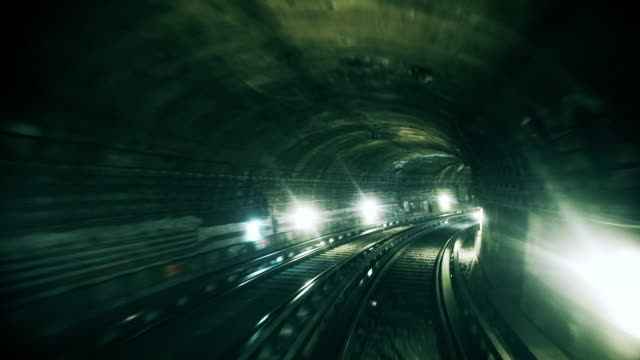 rushing through a metro tunnel - zugperspektive stock-videos und b-roll-filmmaterial