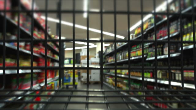 T/L Rushing With Shopping Cart Through Supermarket POV