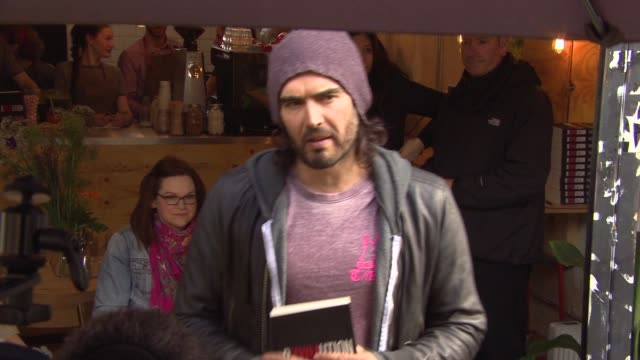 Russell Brand at Russell Brand opens The Trew Era Cafe on March 26 2015 in London England