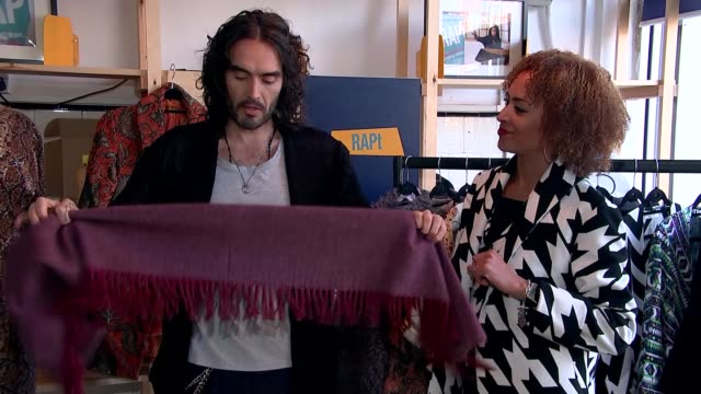 Russell Brand helps recovering drug addicts back into work ENGLAND London Hackney Russell Brand cuts fabric with scissors Close shot 'RAPt recovery...
