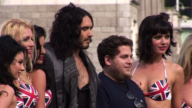 Russell Brand Jonah Hill and glamour girls at the Get Him to the Greek Premiere at London England