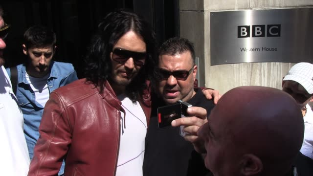 Russell Brand leaves BBC Radio Two Studios after promoting his latest movie 'Arthur' SIGHTED Russell Brand on April 20 2011 in London England