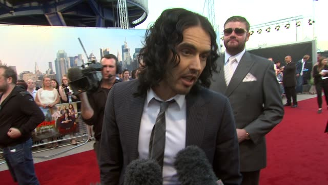 Russell Brand on relating to the character on money on doing kissing scenes on being a good husband at the Arthur European Premiere at London England