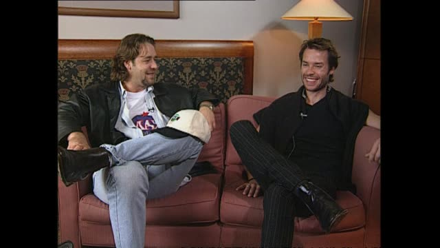 russell crowe and guy pearce speaking in 1997 about actress kim basinger in the film la confidential during interview with reporter ian sinclair - russell crowe stock videos & royalty-free footage
