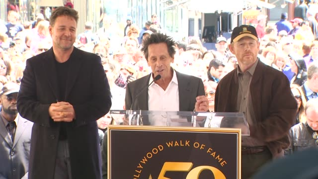 vídeos de stock, filmes e b-roll de russell crowe brian grazer and ron howard at the russell crowe honored with a star on the hollywood walk of fame at hollywood ca - brian grazer