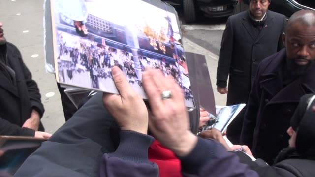 russell crowe exits the good morning america show signs for poses with fans before leaving in celebrity sightings in new york - russell crowe stock videos & royalty-free footage