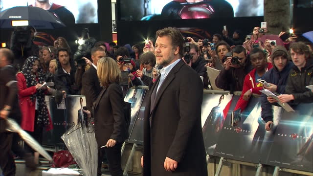 Russell Crowe posing for photo op and signing autographs at premiere of Supermen film Man Of Steel in Leicester Square Russell Crowe photo op and...
