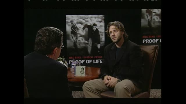 russell crowe speaking about having had an interesting year in 2001 and his desire to see his family during interview with host paul holmes - russell crowe stock videos & royalty-free footage