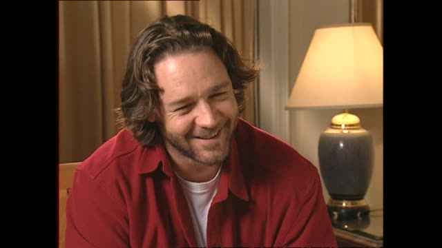russell crowe speaking about the possibility of becoming a dual citizen of both new zealand and australia in 2002 during interview with host paul... - russell crowe stock videos & royalty-free footage